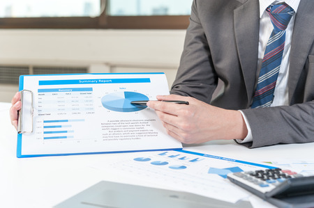 business performance: Businessman show analyzing report, business performance concept