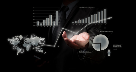 Businessman holding graph, business concept photo