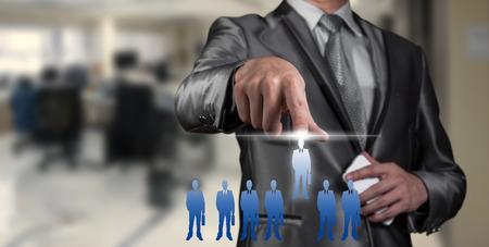 Businessman pressing on digital virtual screen, human resource management concept Stock Photo