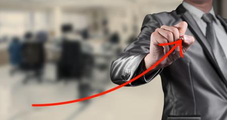 business improvement: businessman draw red curve line, business improvement conceptual