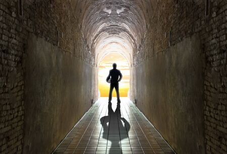 tunnel vision: Businessman standing at tunnel, business strategy concept