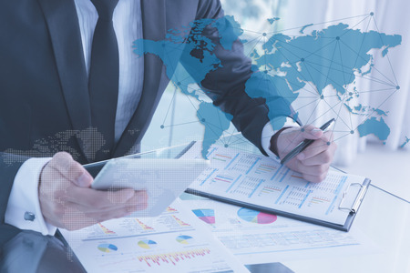 globalization: businessman using tablet, business globalization concept Stock Photo