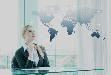 Thoughtful businesswoman in office, business globalization concept 版權商用圖片