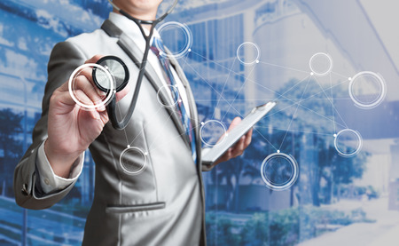 finance problems: Business man with stethoscope, business concept Stock Photo