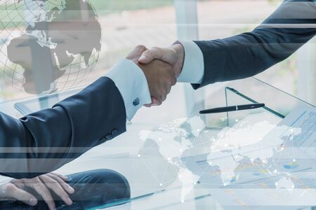 globalization: Business handshake with globalization concept