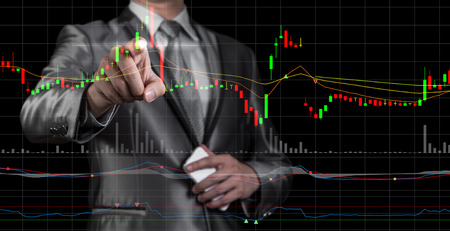 stock investing: double exposure of businessman with stock market chart