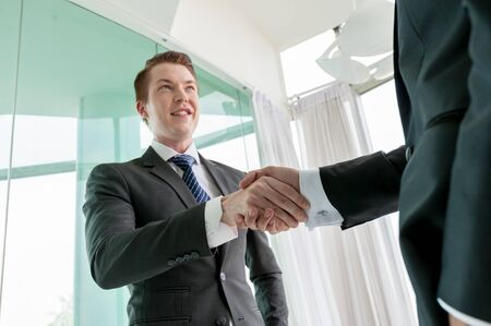 Businessman shaking hand, business situation Stock Photo