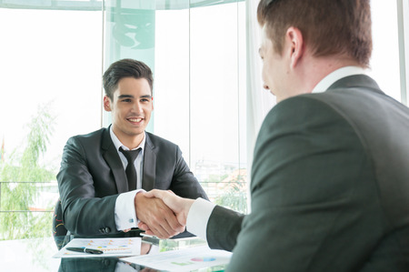two people meeting: Businessman shaking hand, business situation Stock Photo