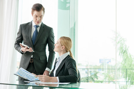 worker man: businessman and woman discussing in office Stock Photo