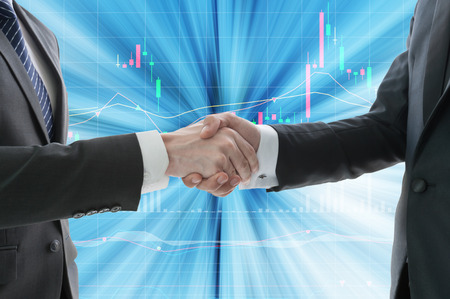 merge together: business hand shake with digital graph in background
