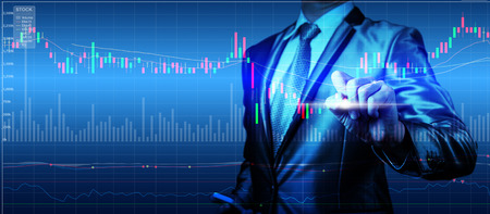 stock chart: double exposure of businessman with stock market chart