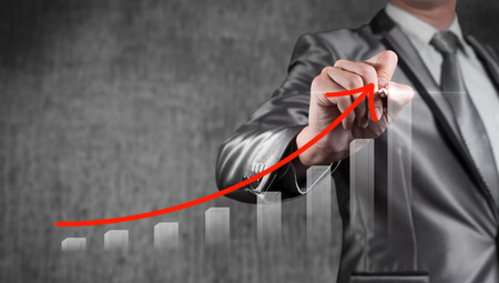 financial advice: Businessman draw red curve with bar chart, business strategy concept Stock Photo