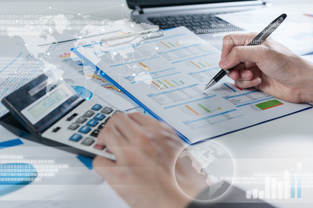 Businessman using calculator, business globalization concept