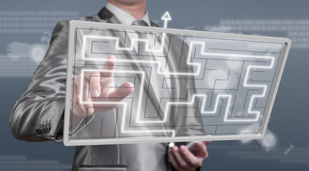 businessman working on digital screen of maze, business strategy concept photo