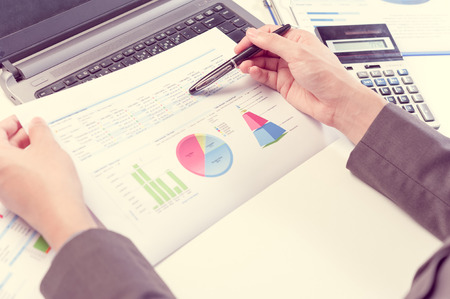 report: Businessman analyzing report, business performance concept