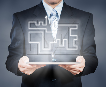 business connections: Businessman using tablet showing maze, business decision concept