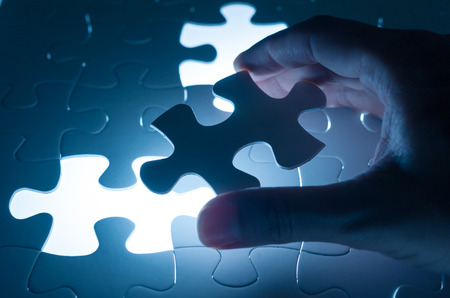 decisions: Hand insert jigsaw, conceptual image of business strategy, decision making concept