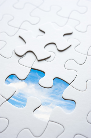 joining hands: Jigsaw piece with sky in hole, conceptual image