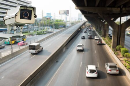 private security: CCTV camera or surveillance operating on traffic road Stock Photo