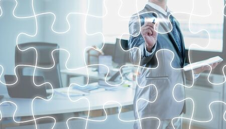 solving: businessman draw jigsaw line, business strategy concept Stock Photo