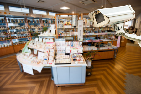 big brother spy: CCTV Camera Operating inside a shop Stock Photo