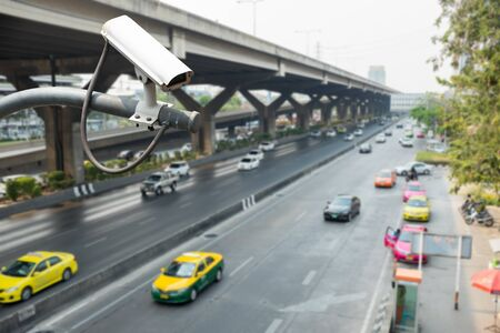CCTV camera or surveillance operating on traffic road Stock Photo