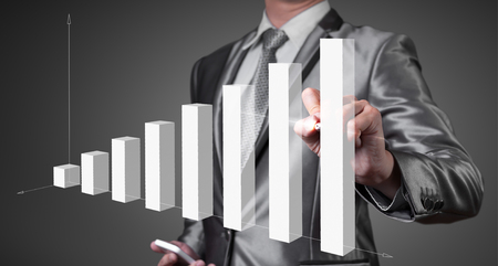 business performance: businessman working with digital chart, business improvement concept Stock Photo