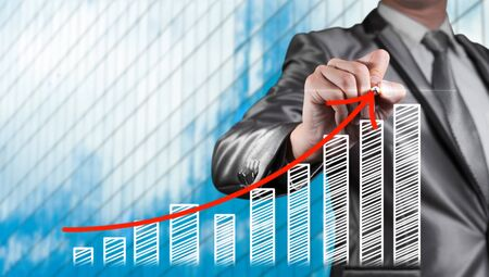 project management: Businessman draw red curve with bar chart, business strategy concept Stock Photo