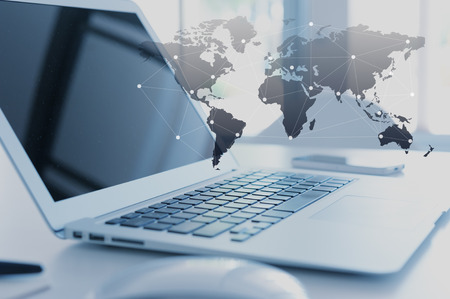 the global: Laptop with globalization concept, technology layer effect Stock Photo