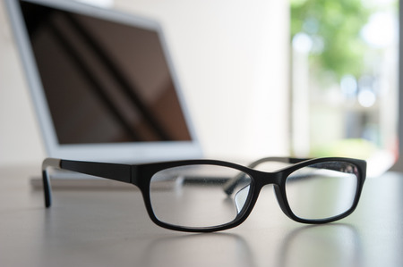 close up glasses on work desk with laptop Stock Photo - 43222839