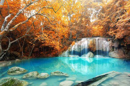 cataract waterfall: Deep forest waterfall in autumn scene at Erawan waterfall National Park Kanjanaburi Thailand Stock Photo