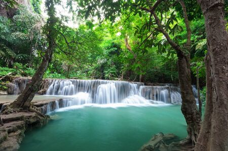 cataract falls: Deep forest waterfall at Huay Mae Kamin waterfall National Park Kanchanaburi Thailand