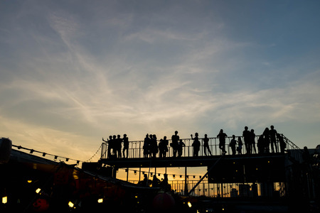 upper floor: Silhouette of  people on upper floor with sunset