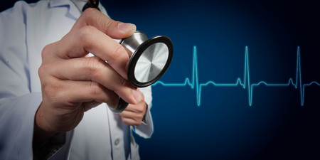 urgent care: Doctor use stethoscope with heart beat graph in background Stock Photo