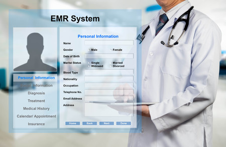 medical person: Doctor working with EMR - Electronic Medical Record system Stock Photo