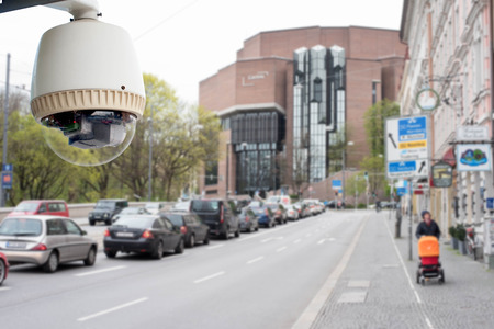 city surveillance: CCTV camera or surveillance operating in city Stock Photo