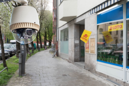 CCTV camera or surveillance operating on walk path in downtown