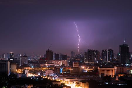 thundershower: Lightning storm over city in purple light