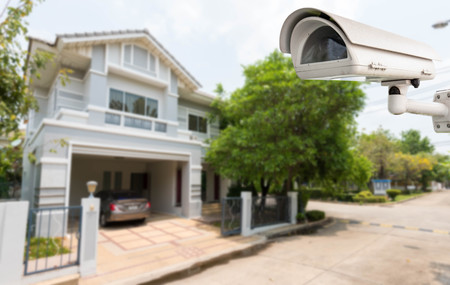 Home security comcept, CCTV camera or surveillance operating in village