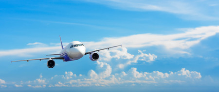 Airplane with background of cloudy sky, exploration conceptual Stock Photo
