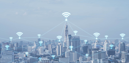 Blue high-tech tone of cityscape conneted line with wifi sign, technology concept, internet of things conceptual Stock Photo