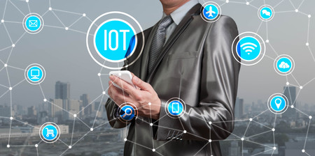 Businessman working with IOT, internet of thing conceptual