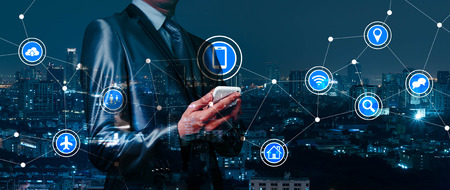 double exposure of businessman working with IOT, internet of thing conceptual