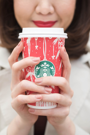 Bangkok ,Thailand December 12 : woman  hold starbucks hot beverage cup in Christmas theme