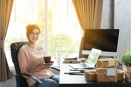Young entrepreneur, teenager business owner work at home, alpha generation life style. morning coffee of an asian teenager