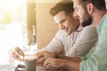 Two Westerner Business men working smartphone and tablet together