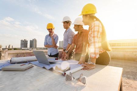 Three construction engineer working in construction site, construction engineering conceptual Standard-Bild