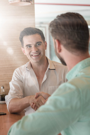Two Westerner Freeelance Business men shaking hands Stock Photo