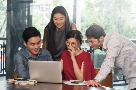 4 people meeting in coffee shop, business casual conceptual Standard-Bild