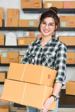 Young entrepreneur, teenager business owner work at home, alpha generation life style. prepare parcel for delivery